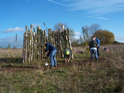 Some of the Friends of Griffin Wood planting the willow screen